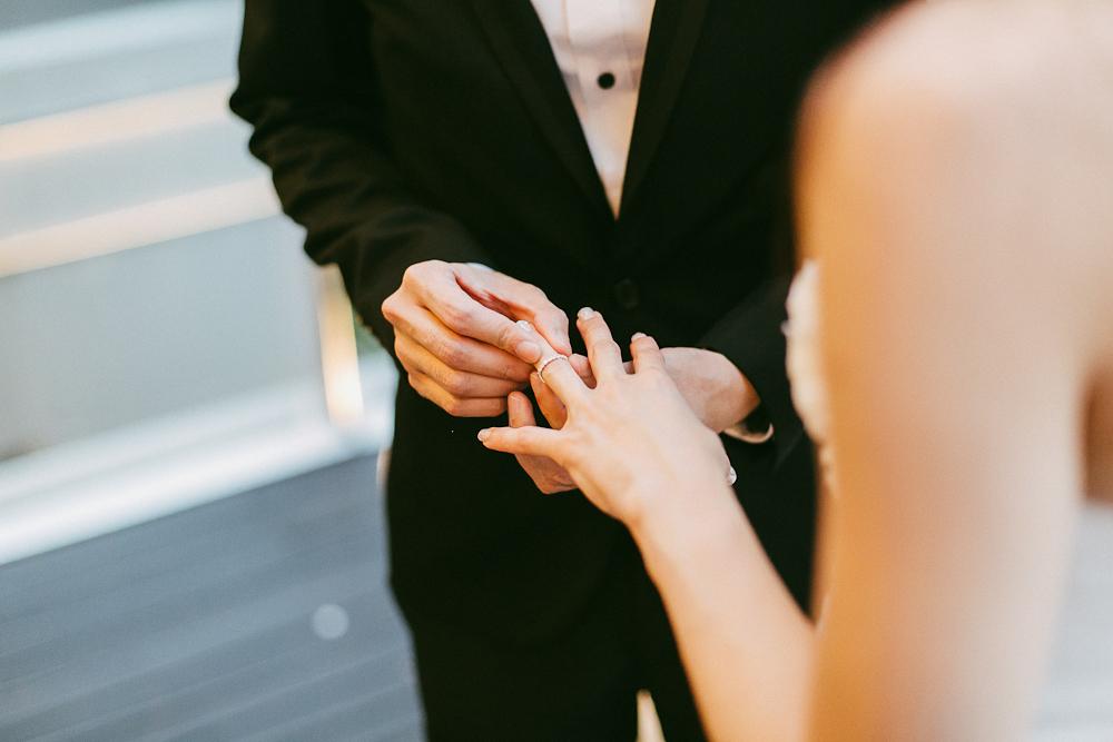 Wedding solemnization Fullerton Bay Hotel exchanging rings