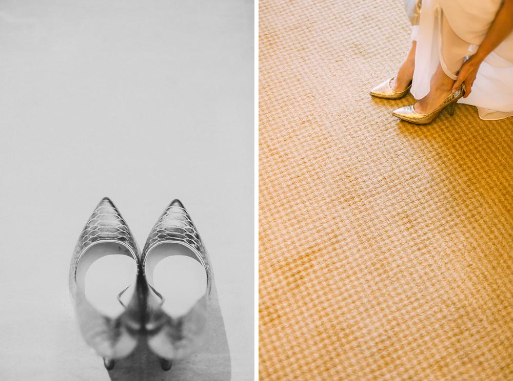 Bride getting ready wearing shoes Fullerton Bay Hotel